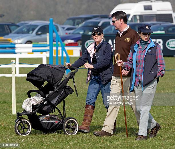 Autumn Phillips pushes daughter Savannah Phillips in her pushchair as she ViceAdmiral Tim Laurence and Princess Anne The Princess Royal attend the...