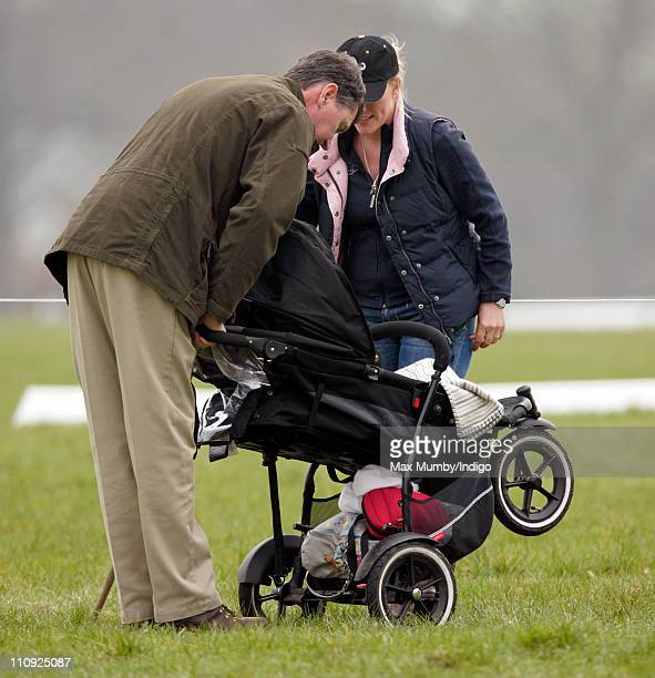 Autumn Phillips pushes daughter Savannah Phillips in her pushchair as she and ViceAdmiral Tim Laurence attend the Gatcombe Park Horse Trials on March...