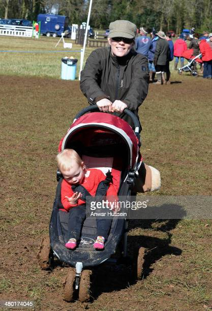 Autumn Phillips pushes her daughter Isla in a pushchair during the Gatcombe Horse Trials at Gatcombe Park on March 23 2014 in Minchinhampton England