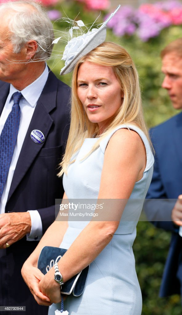 Autumn Phillips watches the horses in the parade ring as she attends the King George Day Meet at Ascot Racecourse on July 26, 2014 in Ascot, England.