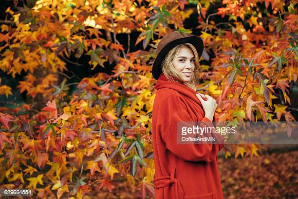 Autumn photo of a beautiful girl