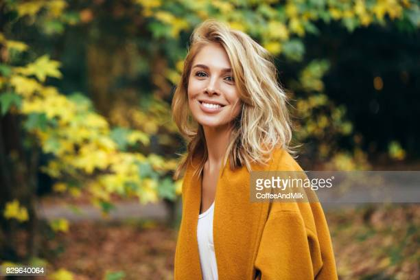 autumn photo of a beautiful girl - front view photos stock photos and pictures