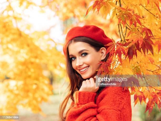 autumn photo of beautiful girl - vestito arancione foto e immagini stock