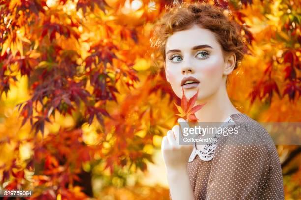 Autumn photo of beautiful girl
