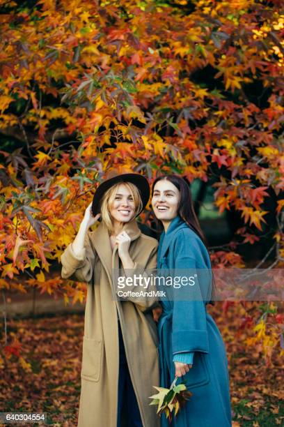 Autumn photo of two beautiful girls