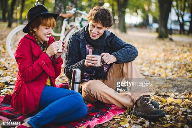 Autumn picnic with cup of hot tea