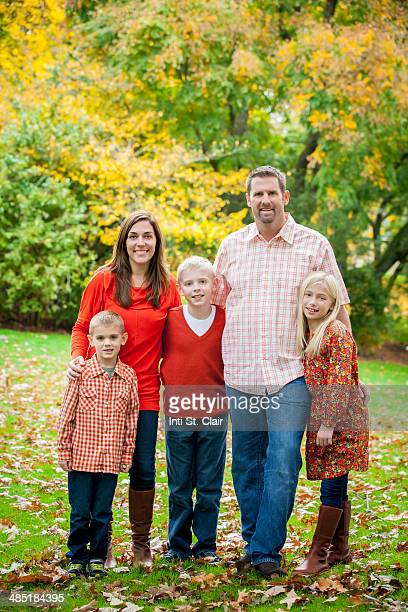 Autumn portrait in park of family of five