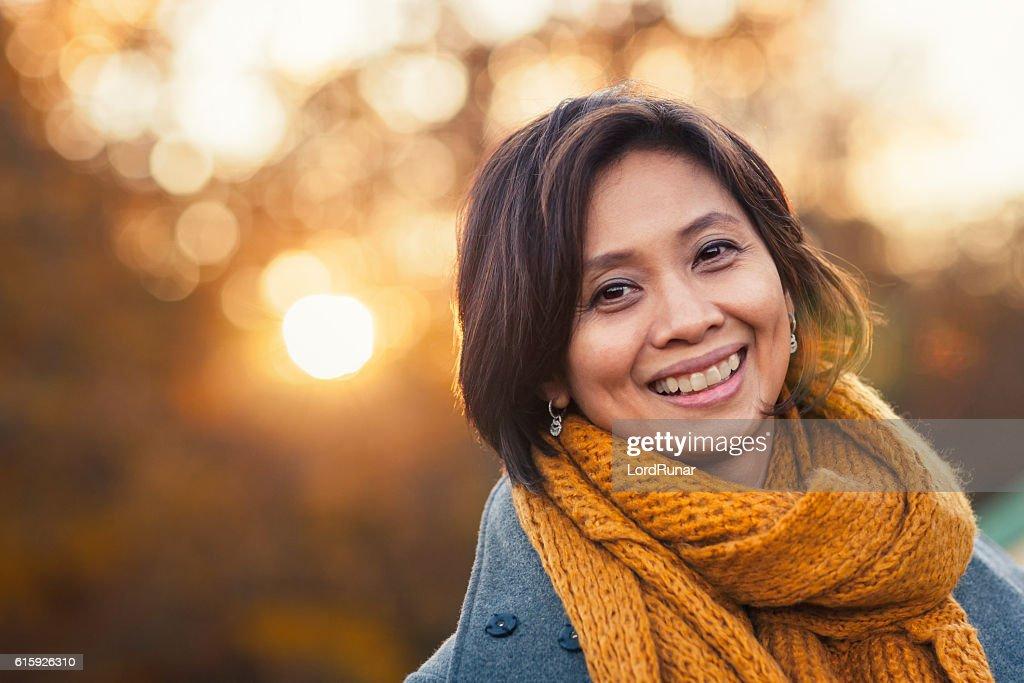 Autumn portrait of a woman : Stock Photo