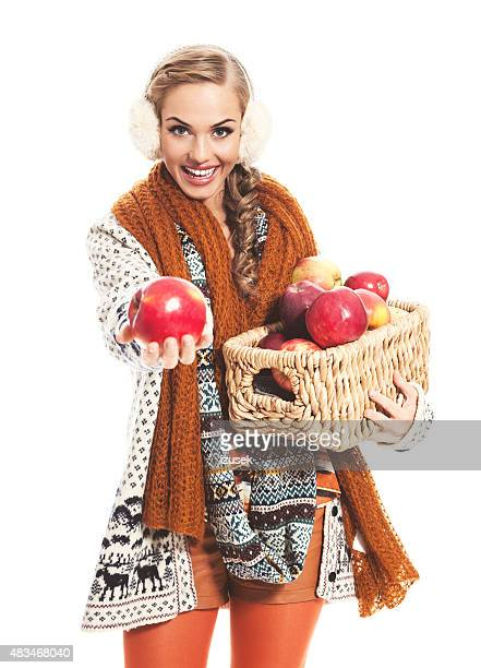 autumn portrait of cheerful blond hair young woman holding apple - cardigan sweater stock pictures, royalty-free photos & images