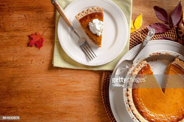 autumn pumpkin pie still life for thanksgiving dinner - sweet pie stock pictures, royalty-free photos & images