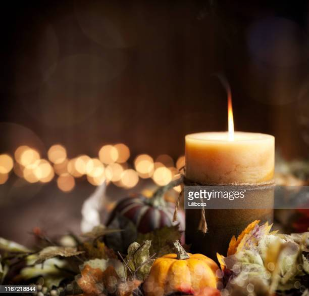 autumn pumpkin wreath and candle background - thanksgiving wallpaper stock photos and pictures