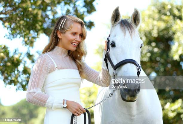 Autumn Racing International Guest Sailor Brinkley Cook pats Mojo the horse during the ATC Autumn Fashion Lunch at Wisteria on April 03 2019 in Sydney...