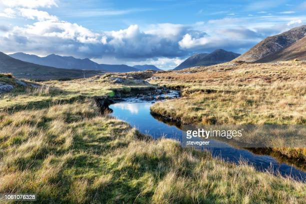 autumn river, maumturk mountains, galway, ireland - county galway stock pictures, royalty-free photos & images