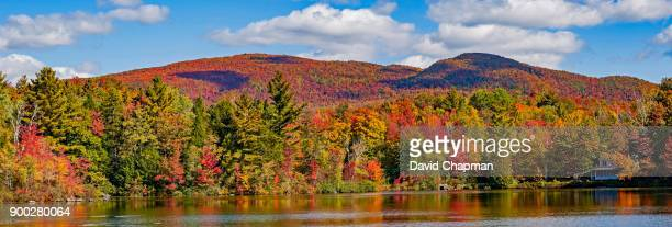 autumn, sallys pond with color change, eastern townships, west bolton, quebec, canada - ケベック州 ストックフォトと画像