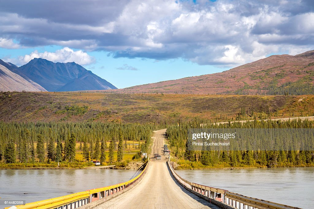 Autumn scenery of mountains and lake on the alaska highway stock autumn scenery of mountains and lake on the alaska highway stock photo voltagebd Images