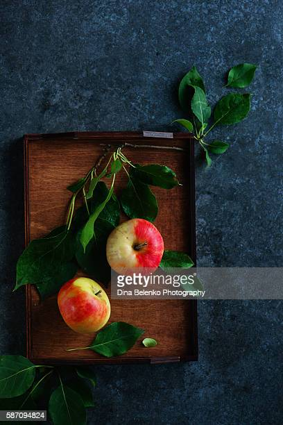 Autumn still life with apples in a wooden crate