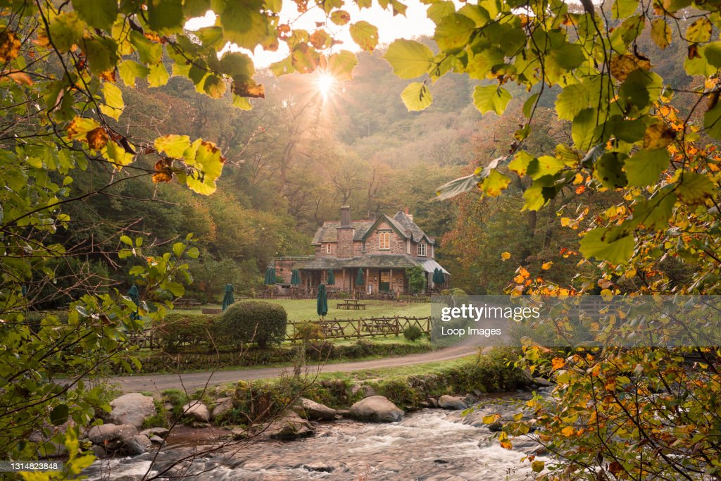 Autumn sunrise over Watersmeet House and the East Lyn River in Exmoor National Park : News Photo