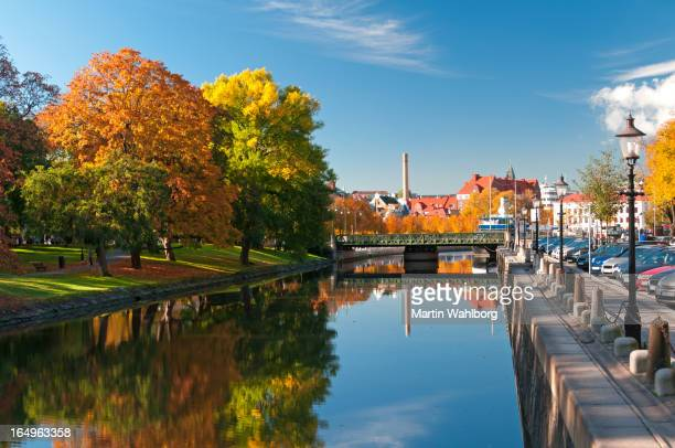autumn trees reflecting on river in rosenlundskanalen - gothenburg stock pictures, royalty-free photos & images