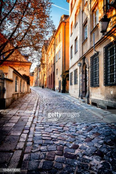 autumn view of the birch street in the morning in warsaw's old town, poland - warsaw stock pictures, royalty-free photos & images