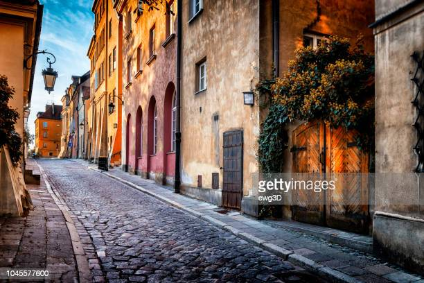 autumn view of the birch street in the morning in warsaw's old town, poland - poland stock pictures, royalty-free photos & images