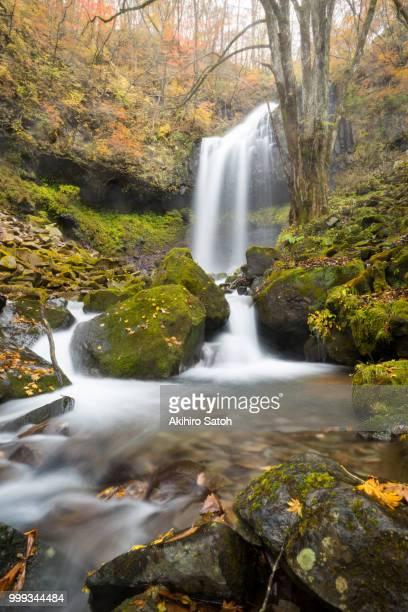 Autumn waterfall in the mist