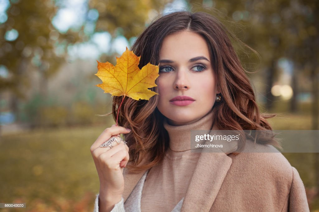 Autumn Woman with Autumn Leaves on Fall Nature Background : Stock Photo