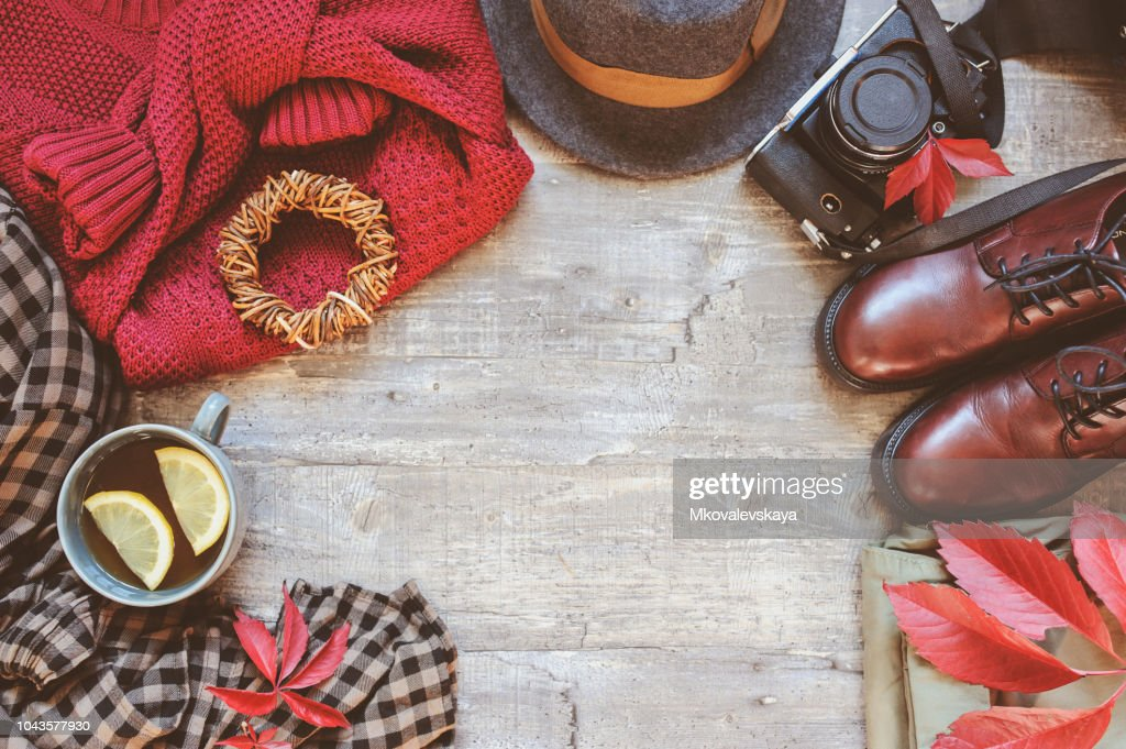 autumn women fashion clothes set with cozy sweater, shoes, plaid shirt, vintage photo camera, hat and cup of tea. Fall seasonal walk concept, flat lay with empty space : Stock Photo