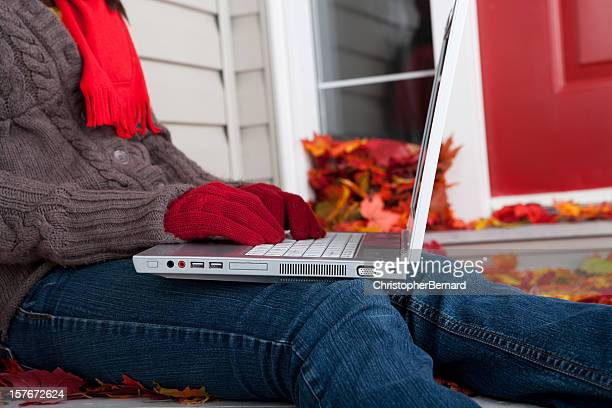 Autumn: Young female using laptop