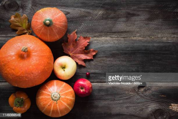 autumnal background with pumpkins, apples, fallen leaves - chestnut food stock pictures, royalty-free photos & images
