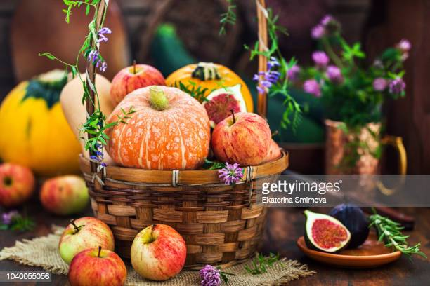 autumnal colorful  pumpkins, apples and figs  on rustic background, hallloween or thanksgiving concept - november background stock photos and pictures