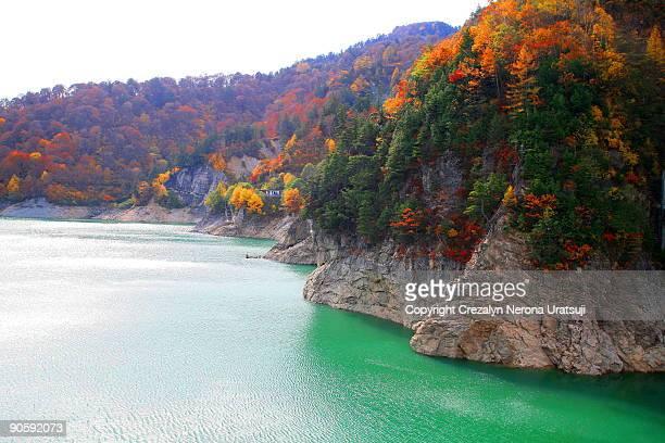 autumnal colours in kurobe - hokuriku region stock photos and pictures