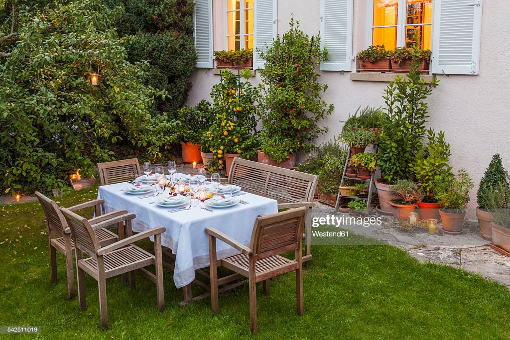 Autumnal laid table in garden in the evening & Outdoor Table Setting Stock Photos and Pictures | Getty Images