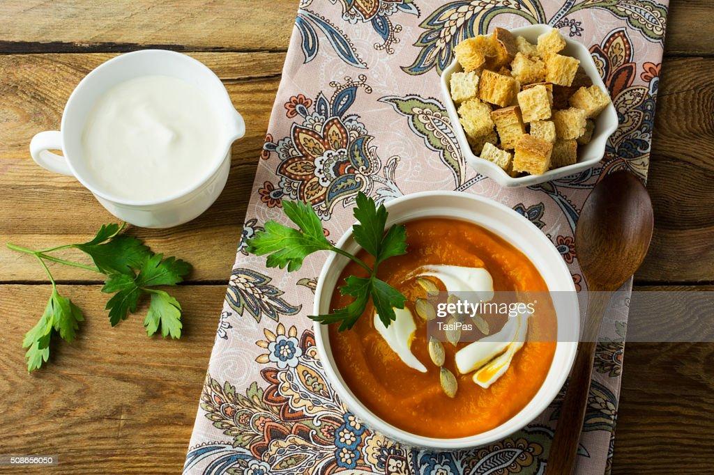 Autumnal spicy pumpkin cream soup : Stock Photo
