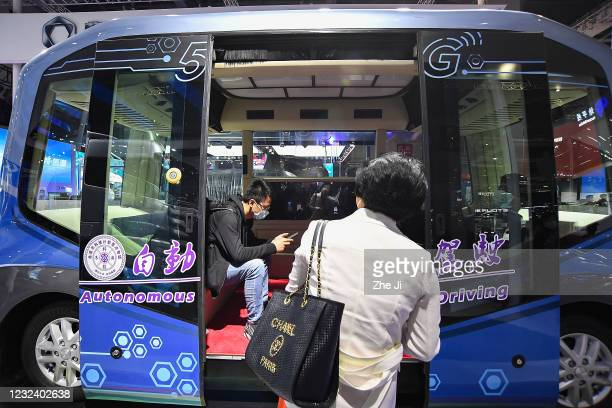 Auv autonomous driving mini bus is displayed at Foton Daimler booth during the 19th Shanghai International Automobile Industry Exhibition, also known...