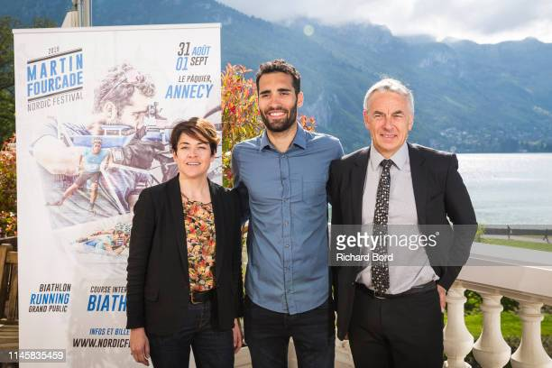 AuvergneRhoneAlpes county Vice President Annabel AndreLaurent Biathlete and Promoter Martin Fourcade and Annecy Mayor JeanLuc Rigaut pose before the...