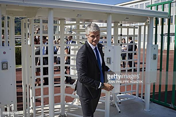 AuvergneRhoneAlpes region chairperson Laurent Wauquiez passes through the new gate of the 'Galilee' highschool on September 1 in Vienne where the...