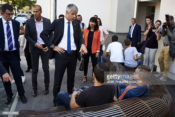 AuvergneRhoneAlpes region chairperson Laurent Wauquiez talks with pupils at the 'Galilee' highschool on September 1 in Vienne where the securing...