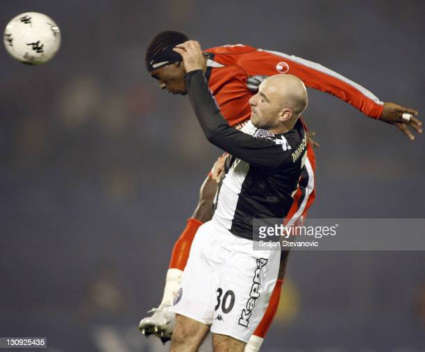 Auxerre player Oumar Kalabane above jump for the ball with Nenad Mirosavljevic from Partizan Belgradeduring Uefa Cup Group A match between Partizan...