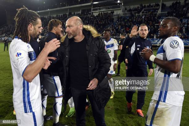 Auxerre's coach Cedric Daury jubilates with Auxerre's players at the end of the French Cup football match between AJ Auxerre and AS SaintEtienne on...