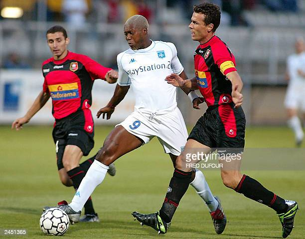 Auxerre's forward Djibril Cisse fights for the ball with Rennes' midfielder Cedric Barbosa and Defender Dominique Arribage during their French L1...