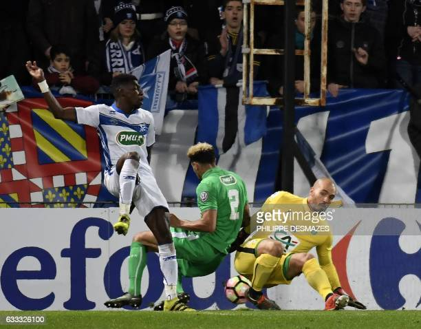 Auxerre's French defender KenjiVan Boto vies with SaintEtienne's French defender Kevin Malcuit and SaintEtienne's French goalkeeper Jessy Moulin...