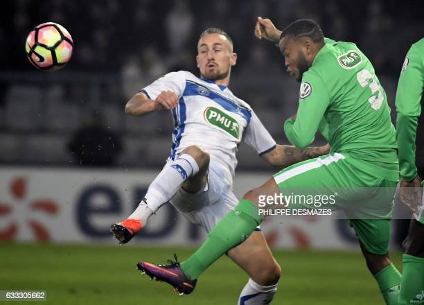 Auxerre's French forward Gaetan Courtet vies with SaintEtienne's French defender PierreYve Polomat during the French Cup football match between AJ...