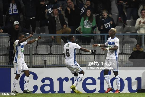 Auxerre's French forward Mohamed Yattara is congratulated by teammates after scoring during the French Cup football match AJ Auxerre against AS...