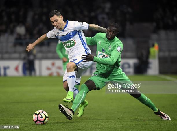Auxerre's French midfielder Ludovic Obraniak vies with SaintEtienne's French midfielder Bryan Dabo during the French Cup football match between AJ...