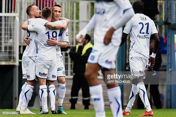 Auxerre's French midfielder Vincent Gragnic celebrates with teammates after scoring a goal during the L2 football match Auxerre vs Dijon on April 23...