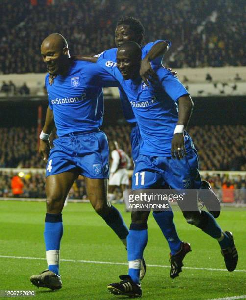 Auxerre's Khalilou Fadiga celebrates after scoring their second goal with Benjani and JeanAlain Boumsong during the Champions League match against...