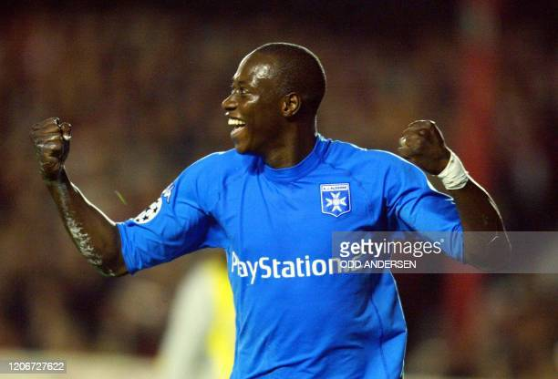 Auxerre's Khalilou Fadiga celebrates after scoring their second goal against Arsenal during the Champions League match at Highbury stadium in north...