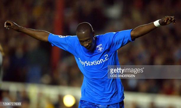 Auxerre's Khalilou Fadiga celebrates after scoring their second goal during the Champions League match against Arsenal at Highbury stadium in north...
