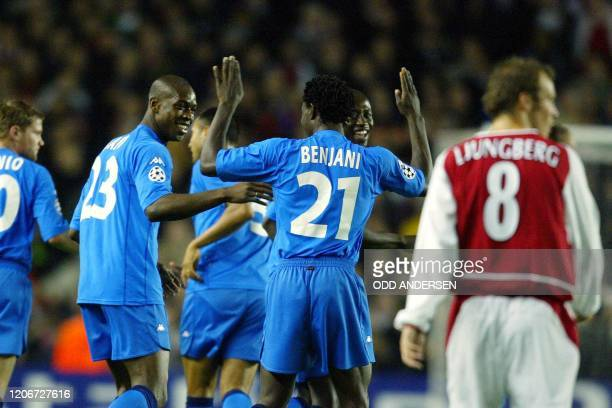 Auxerre's Olivier Kapo is congratulated by his teammate Benjani after scoring an early goal while Arsenal's Freddie Ljungberg looks back at goal...
