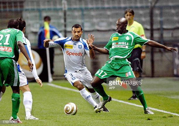 Auxerre's player Jean Sebastien Jaures fights for the ball with SaintEtienne's player Rudolf Douala 25 September 2007 at AbbeDeschamp stadium in...